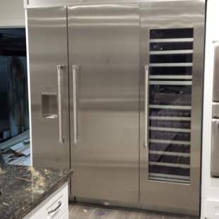 3 column Thermador refrigerator finished with door reversed to open a certain way per cust